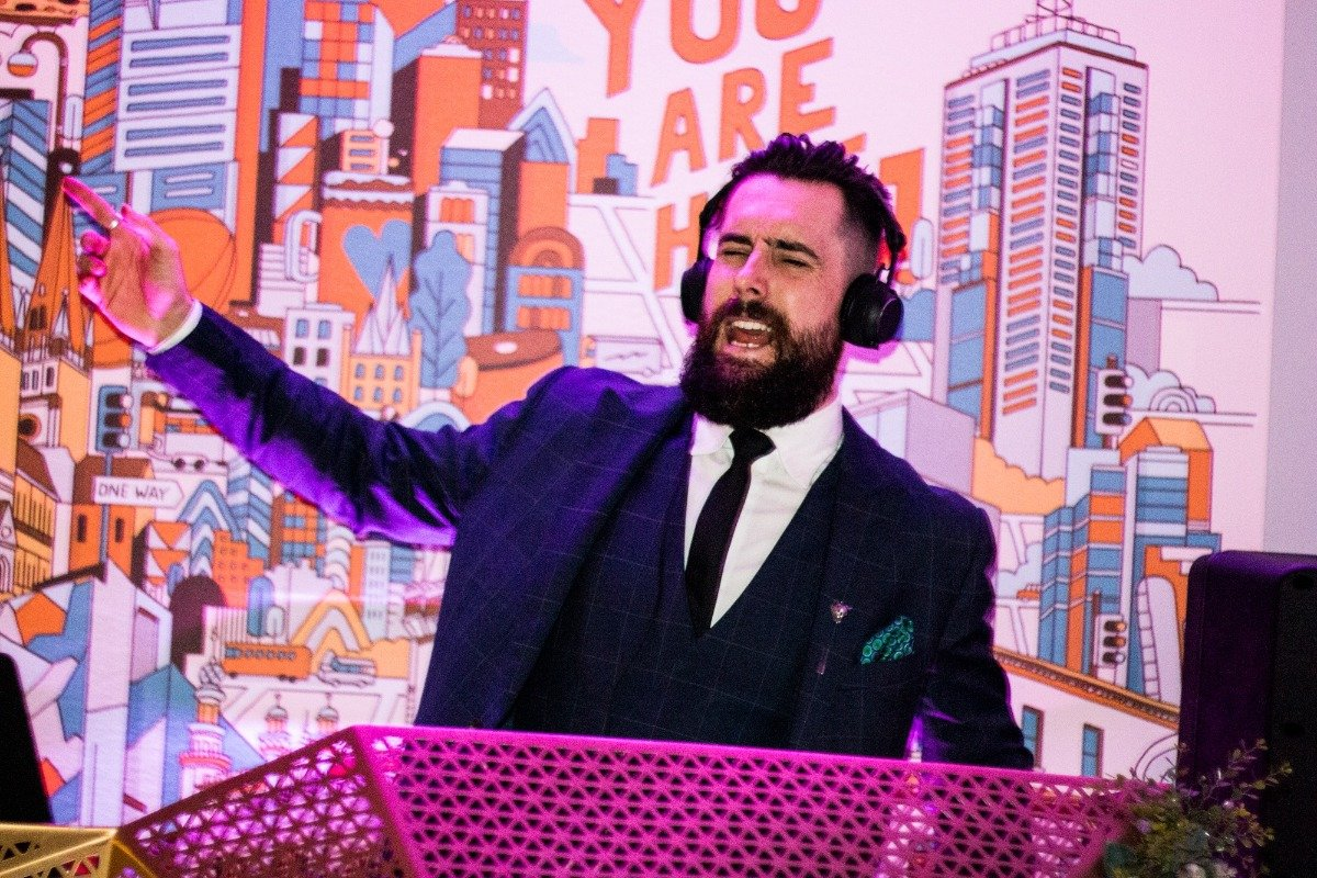 Wedding DJ Gets The Party Going With Popular Songs