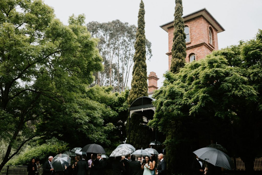 Willow And Stone Estate Wedding Guests Walking To Ceremony Near Heritage Building