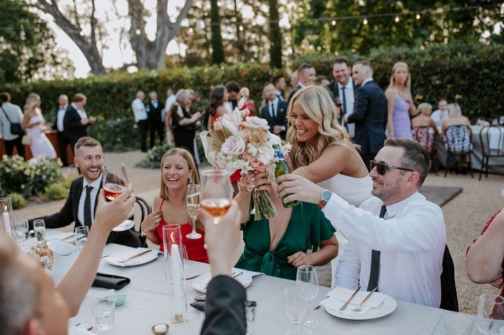 Bide And Guests Raising Glasses To Celebrate A Wedding At Euroa Butter Factory