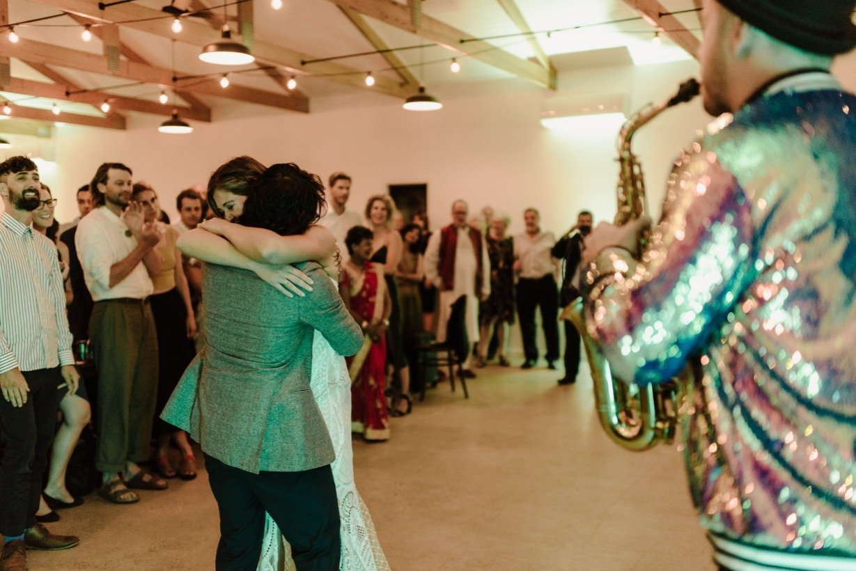 Bride And Groom Sway To First Dance With Saxophone