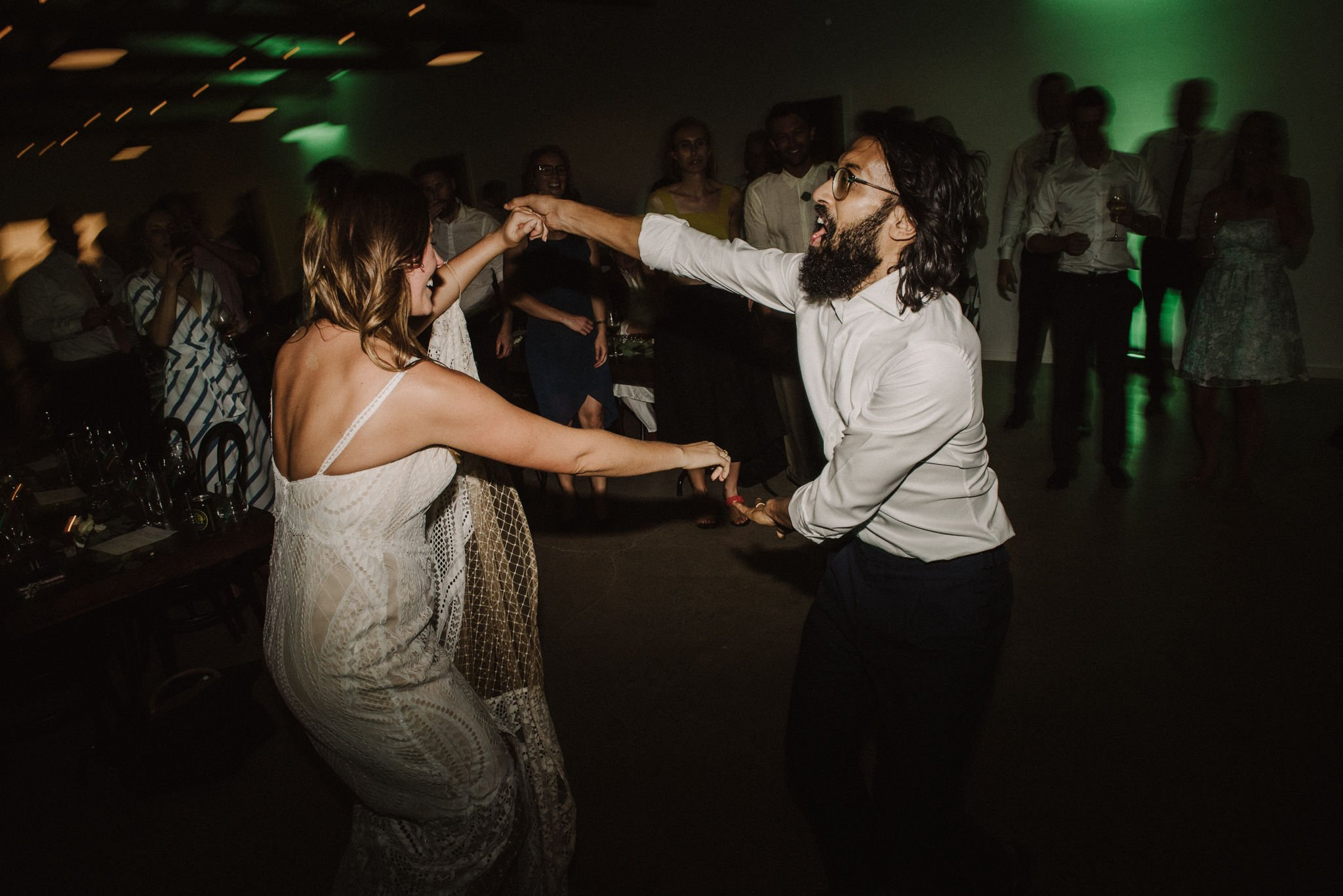 Bride And Groom Dancing With Friends And Family Circled Around Them