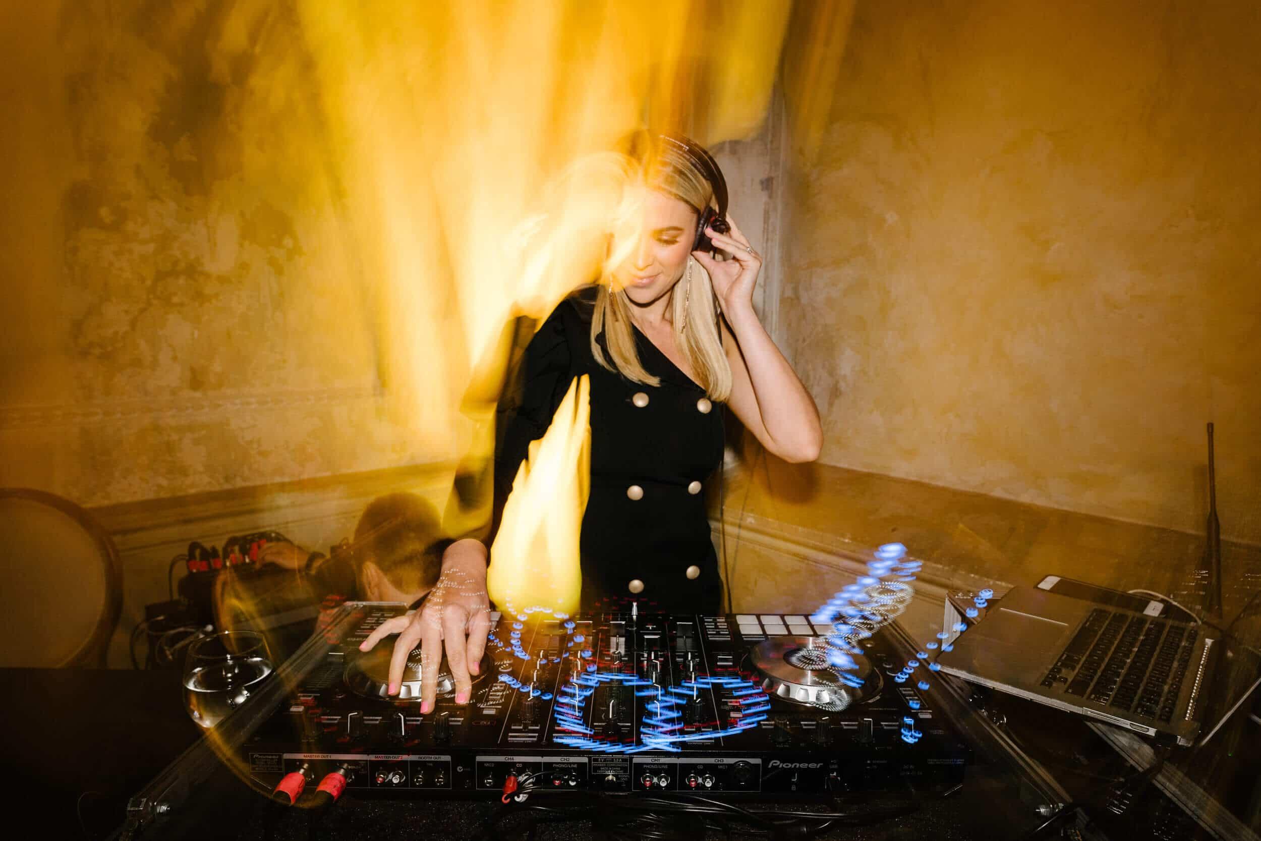 Female DJ Behind Decks At Melbourne Wedding