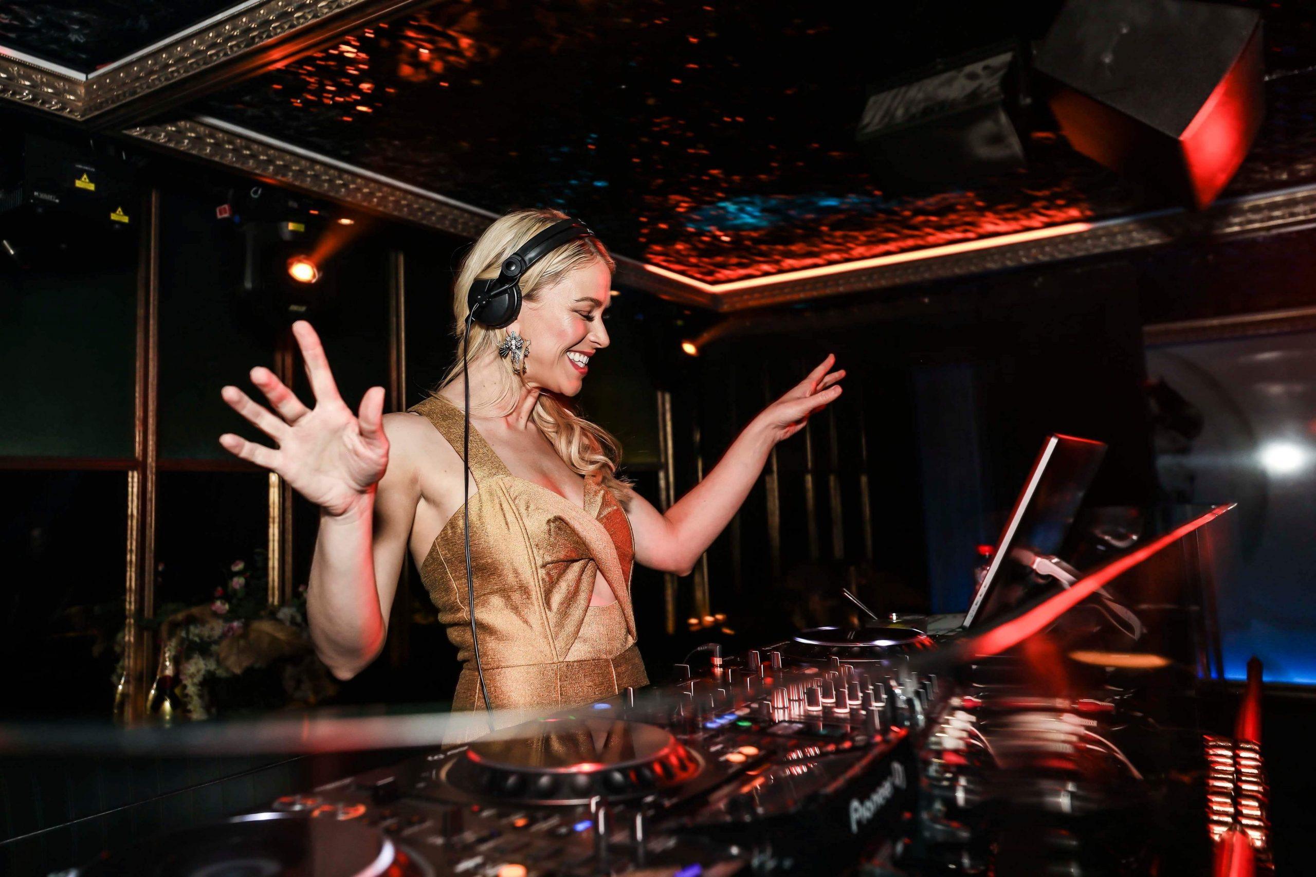 DJ Emma Behind Decks At Event