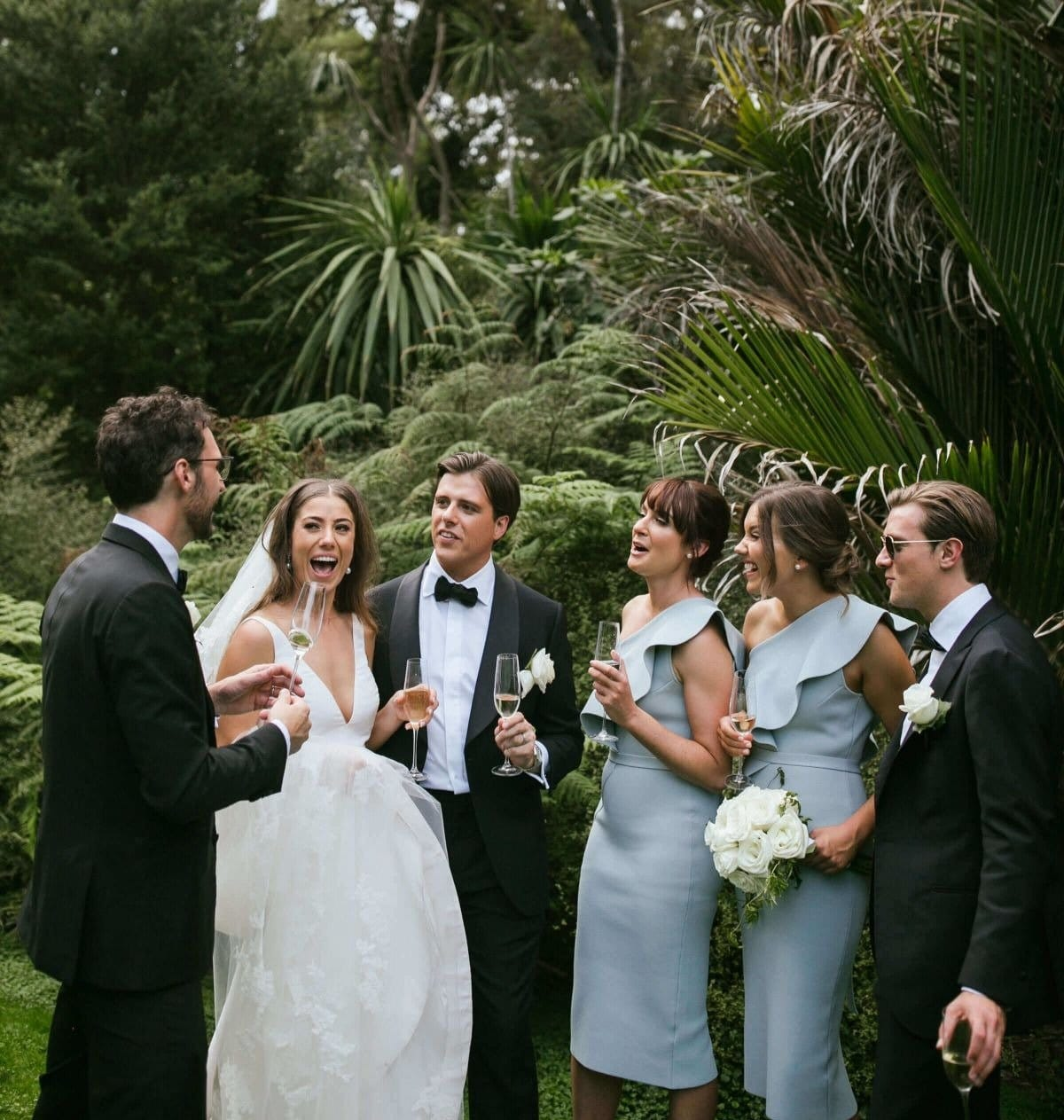 Bridal Party Poses In Melbourne Botanical Gardens For Wedding Photos