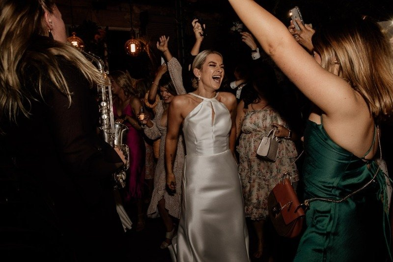 Bride Dances With Female Sax Player At Glasshaus Inside Melbourne