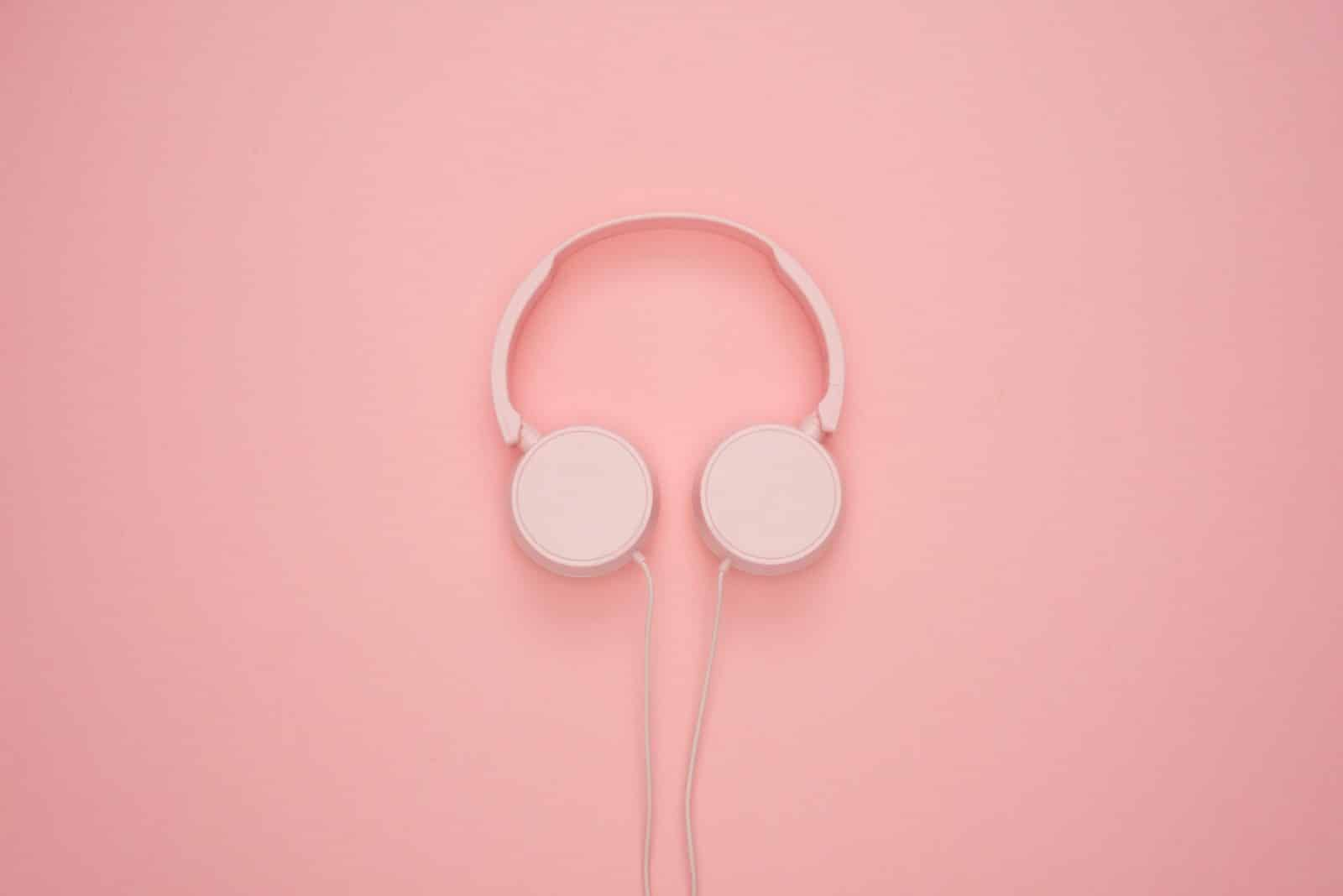 White Headphones On Pastel Pink Background