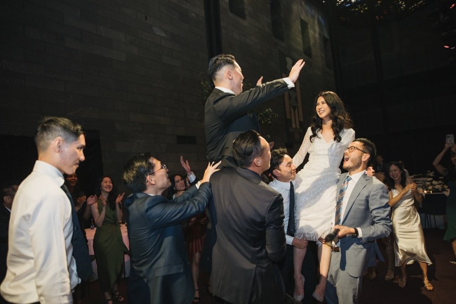 Wedding Couple Dance On Guests' Shoulders AT National Gallery Of Victoria Wedding