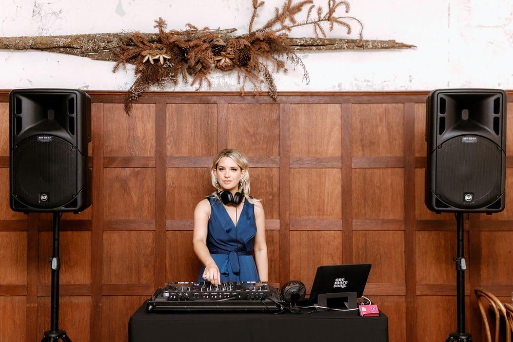 Female DJ Aleks Mac Poses Behind Decks At Little Henri Thornbury Wedding