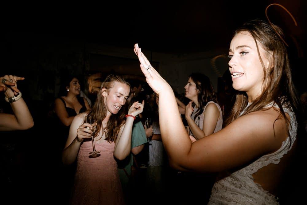 Bride Dances With Guest At Wedding In Thornbury