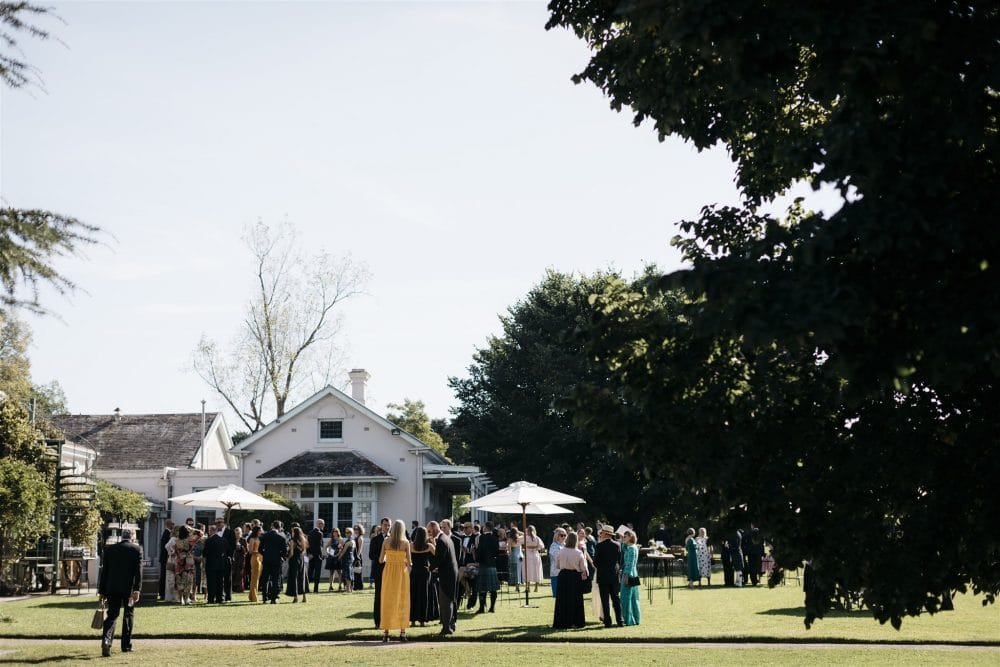 Guests Enjoy Drinks After Wedding Ceremony Outdoors At Coombe Yarra Valley