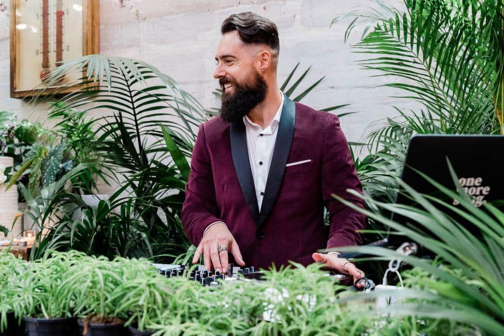 Wedding DJ Eddy Mac Poses Behind The Decks At Glasshaus Melbourne
